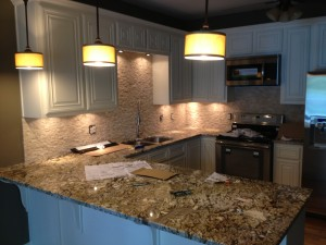 Under cabinet lighting and pendant lights.